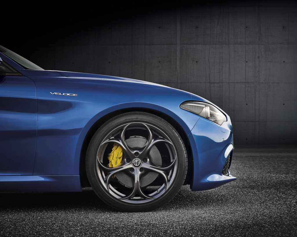 Blue Alfa Romeo Giulia Veloce front brakes with yellow brake calipers