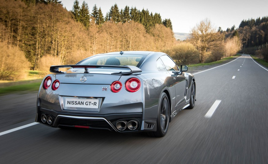 Grey 2017 Nissan GT-R driving on the open road