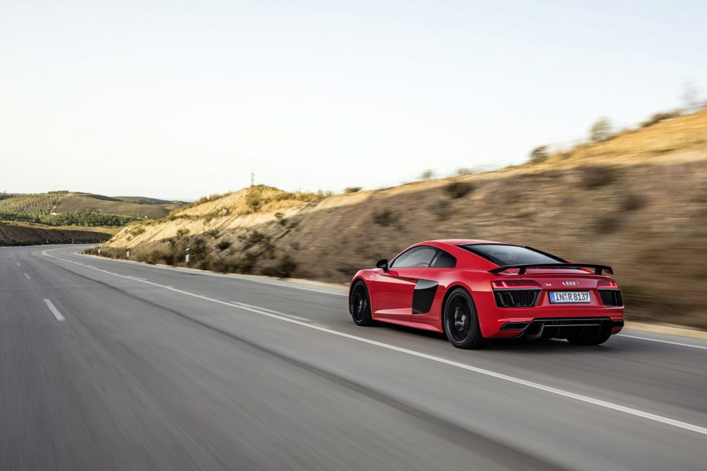 Catalunya Red Audi R8 V10 plus rear angle driving on open road