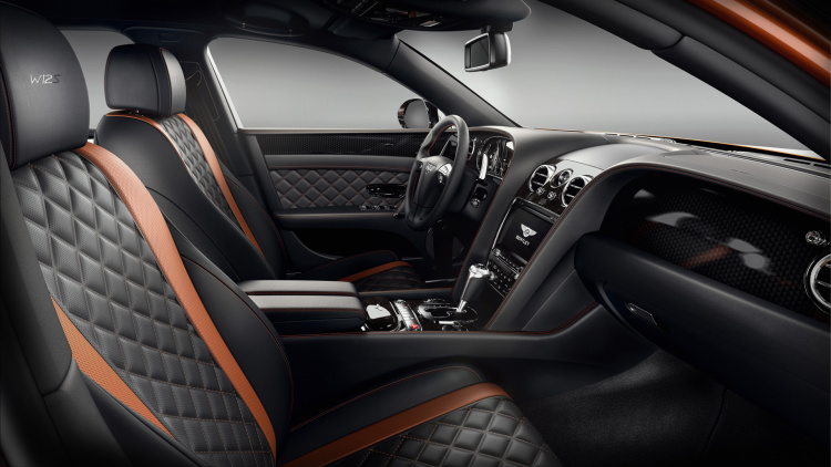 Bentley Flying Spur W12 S interior shows black leather seats with orange accents