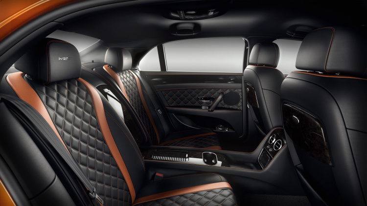 Bentley Flying Spur W12 S interior shows rear seats with black leather and orange accents