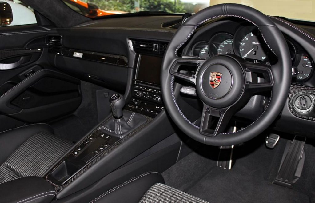 Porsche 911 R interior with manual gearbox and black leather seats