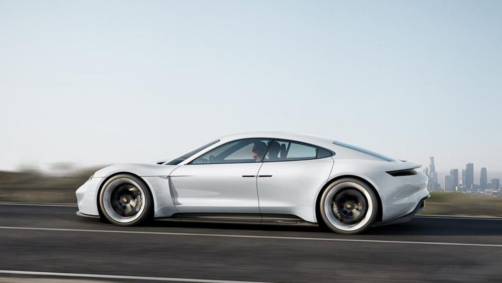 Concept Porsche Mission E Being Driven by a man side profile