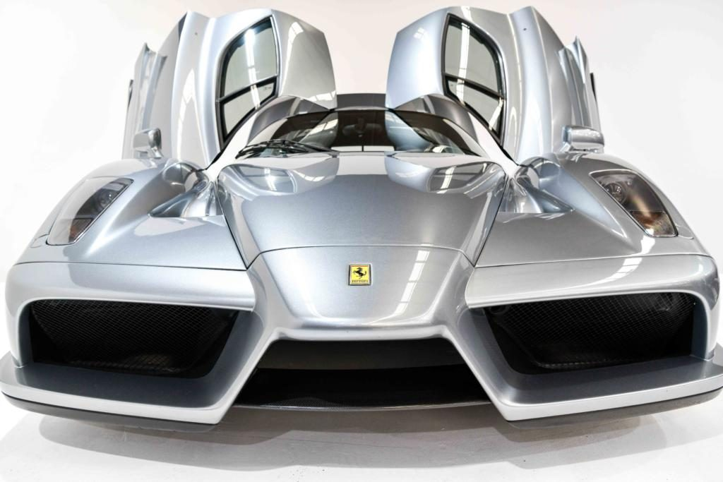 SIlver Ferrari Enzo with gullwing doors open front end