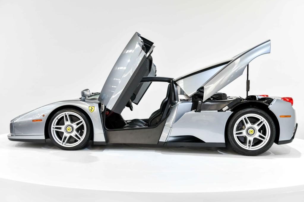 Silver Ferrari Enzo gullwing doors and boot open