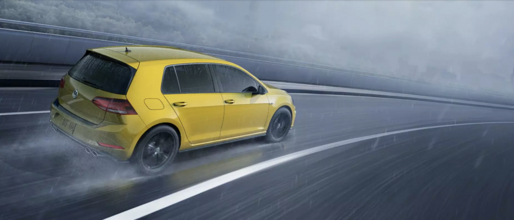 2019 Volkswagen Golf R in Yellow Driving on wet road