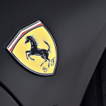 Ferrari yellow badge on black background