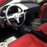 Red Ferrari F40 interior and steering wheel