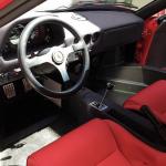 Red Ferrari F40 interior and steering wheel